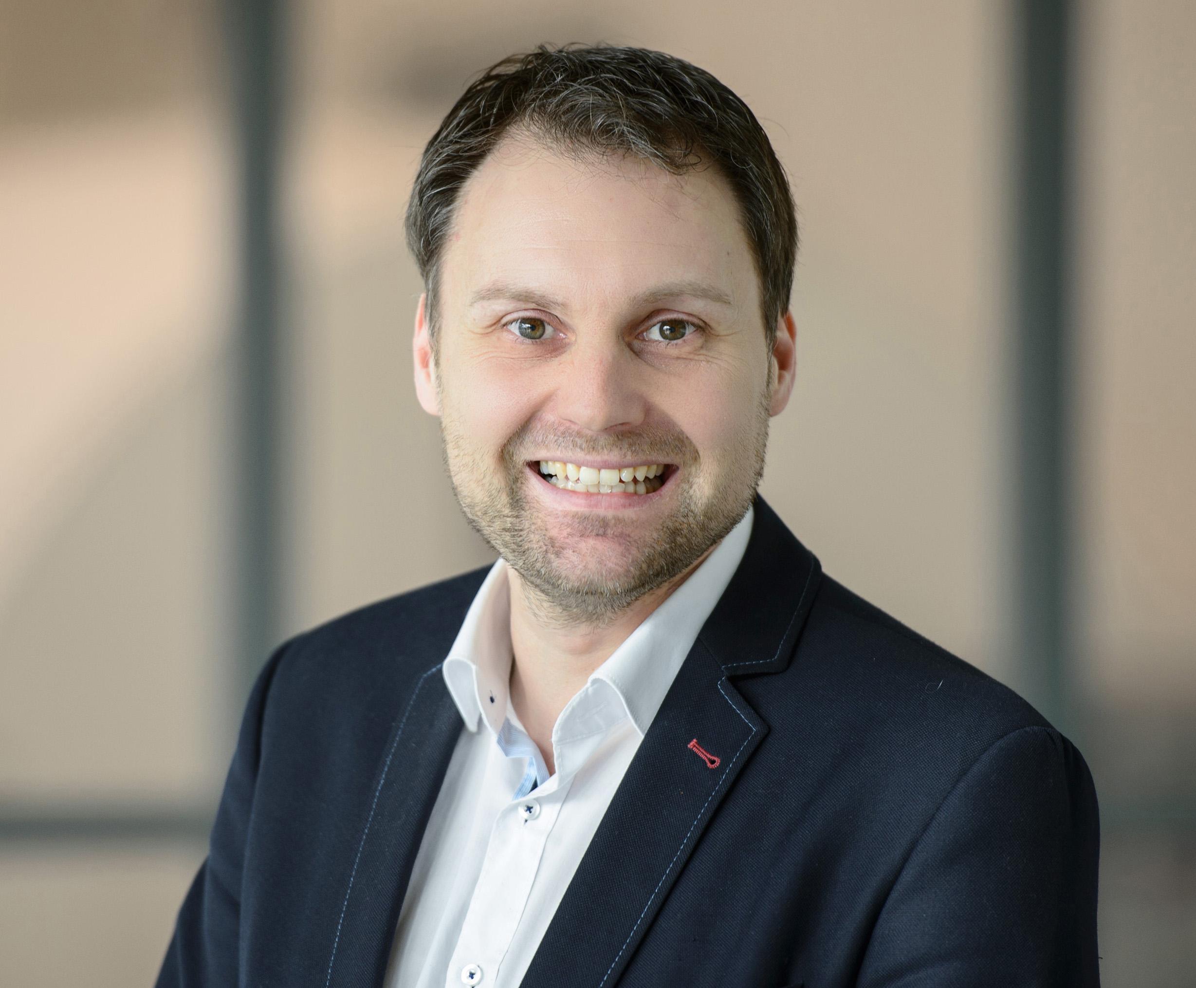 Dr. Jörg Merlein